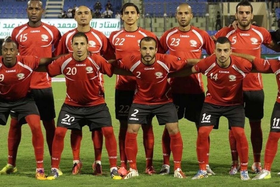 Palestine-2014-LEGEA-home-kit-red-black-red-line-up.jpg