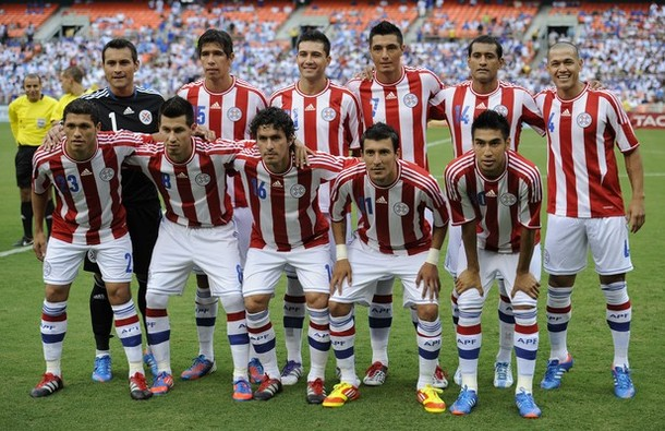 Paraguay-11-12-adidas-home-kit-stripe-white-white-pose.jpg