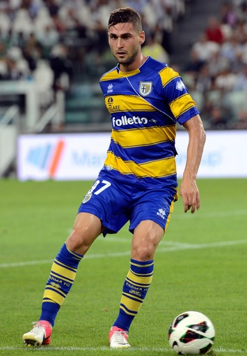 Parma-12-13-third-kit-yellow-blue-yellow-Aleandro-Rosi.jpg