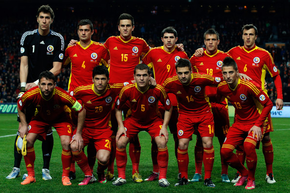 Romania-12-13-adidas-away-kit-red-red-red-line-up.jpg