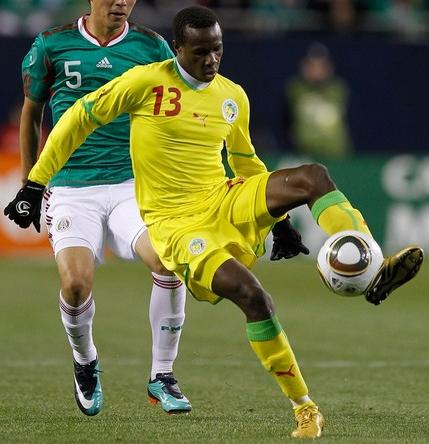 Senegal-10-11-PUMA-away-kit-yellow-yellow-yellow.JPG