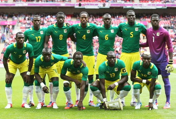 Senegal-12-PUMA-Olympic-away-kit-green-yellow-white-line-up.jpg