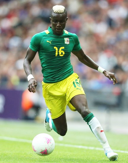 Senegal-12-PUMA-Olympic-away-kit-green-yellow-white.jpg
