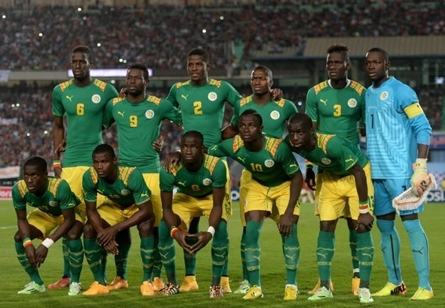 Senegal-2014-PUMA-home-kit-green-yellow-green-line-up.jpg