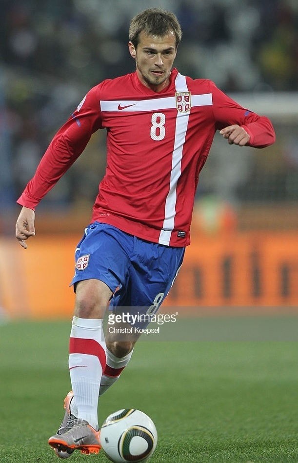 Serbia-2010-NIKE-home-kit-red-blue-white.jpg