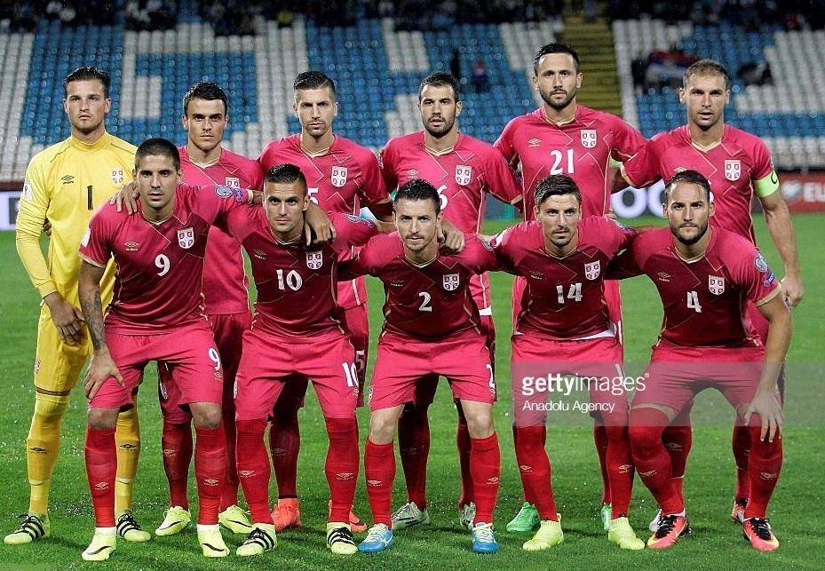 Serbia-2014-15-umbro-home-kit-red-red-red-line-up.jpg