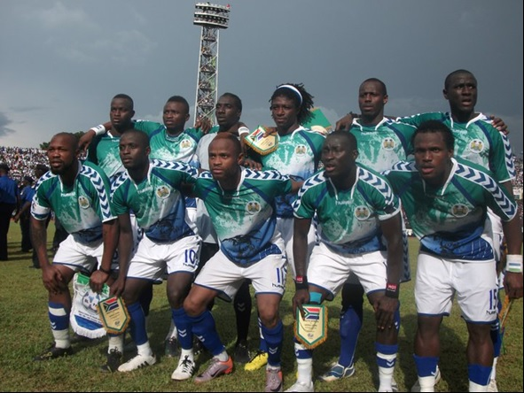 Sierra-Leone-10-hummel-home-kit-green-white-blue-pose.jpg