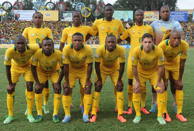 South-Africa-12-13-PUMA-home-kit-yellow-yellow-yellow-line-up.jpg