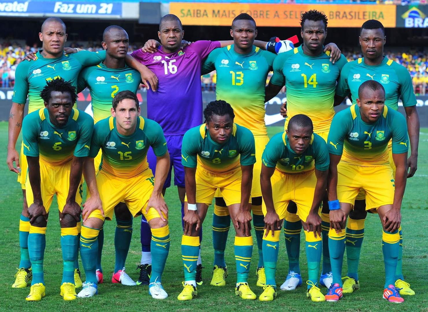 South Africa-12-13-PUMA-away-kit-green-yellow-green-line-up.jpg