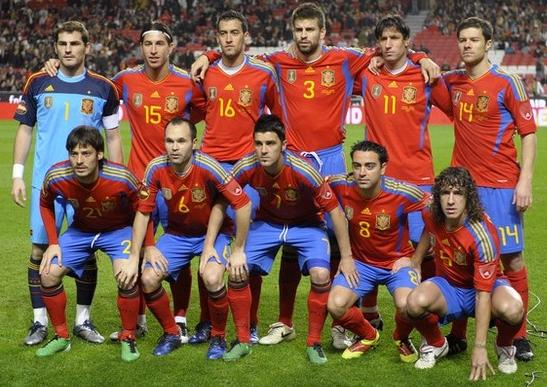 Spain-11-12-adidas-home-kit-red-blue-red-pose.jpg