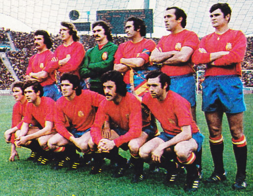 Spain-76-unknown-home-kit-red-blue-black-line-up.jpg