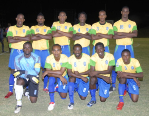 St. Vincent-Grenadines-09-FinTA-home-kit-yellow-blue-blue-line-up.jpg