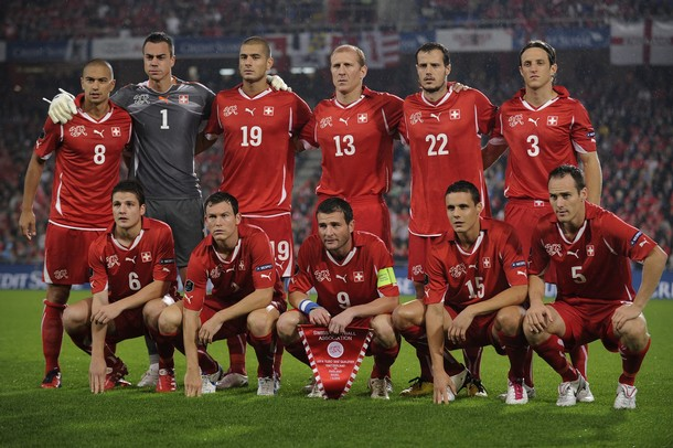 Switzerland-10-11-PUMA-home-kit-red-red-red-pose.JPG
