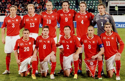 Switzerland-10-11-PUMA-home-kit-red-white-red-pose.JPG