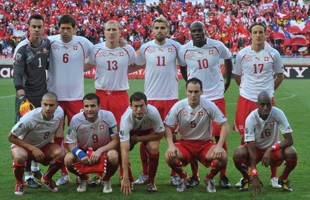 Switzerland-10-PUMA-WorldCup-away-kit-white-red-red-pose.jpg