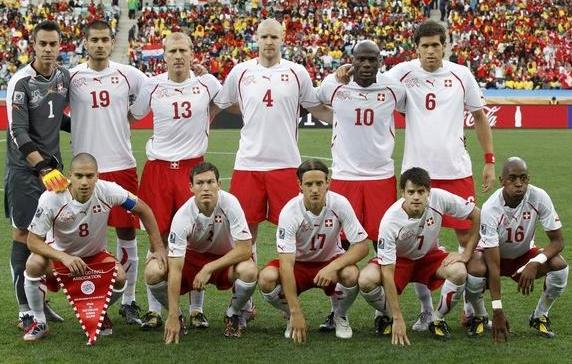Switzerland-10-PUMA-WorldCup-away-kit-white-red-white-pose.jpg