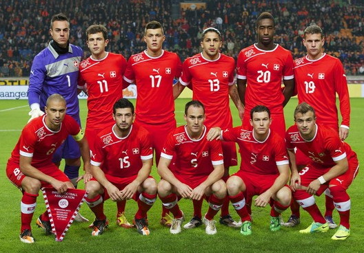 Switzerland-12-13-PUMA-home-kit-red-red-red-line-up.jpg