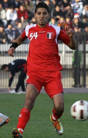 Syria-10-11-DIADORA-home-kit-red-red-red.jpg
