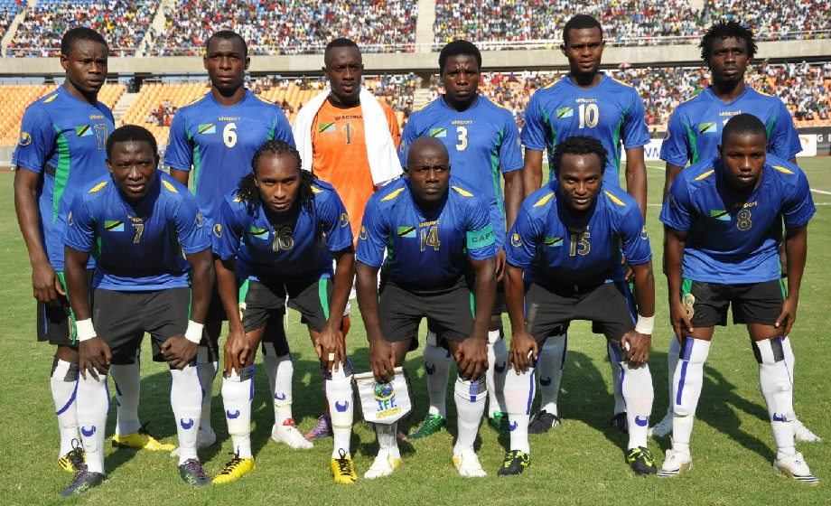 Tanzania-12-uhlsport-home-kit-blue-black-white-line-up.jpg
