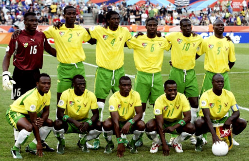 Togo-06-07-PUMA-uniform-yellow-green-white-group.JPG