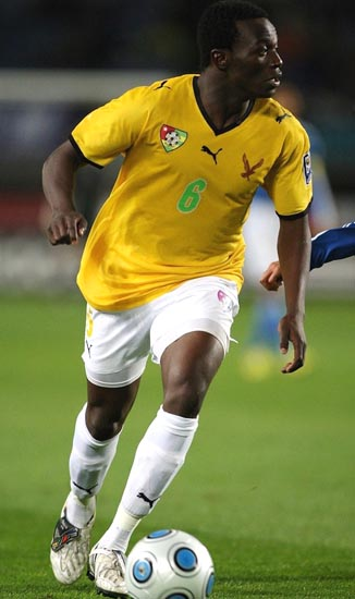 Togo-09-PUMA-uniform-yellow-white-white.JPG