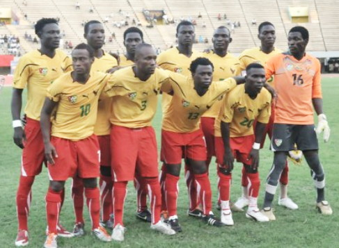 Togo-11-PUMA-home-kit-yellow-red-red-line-up.jpg