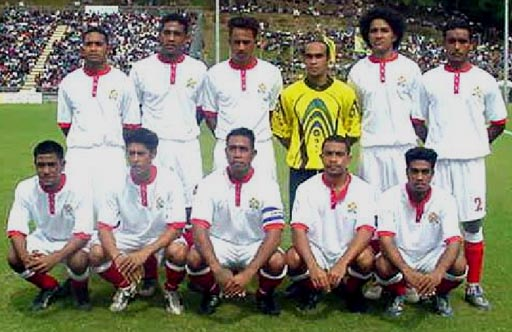 Tonga-04-unknown-away-kit-white-white-red-line-up.JPG