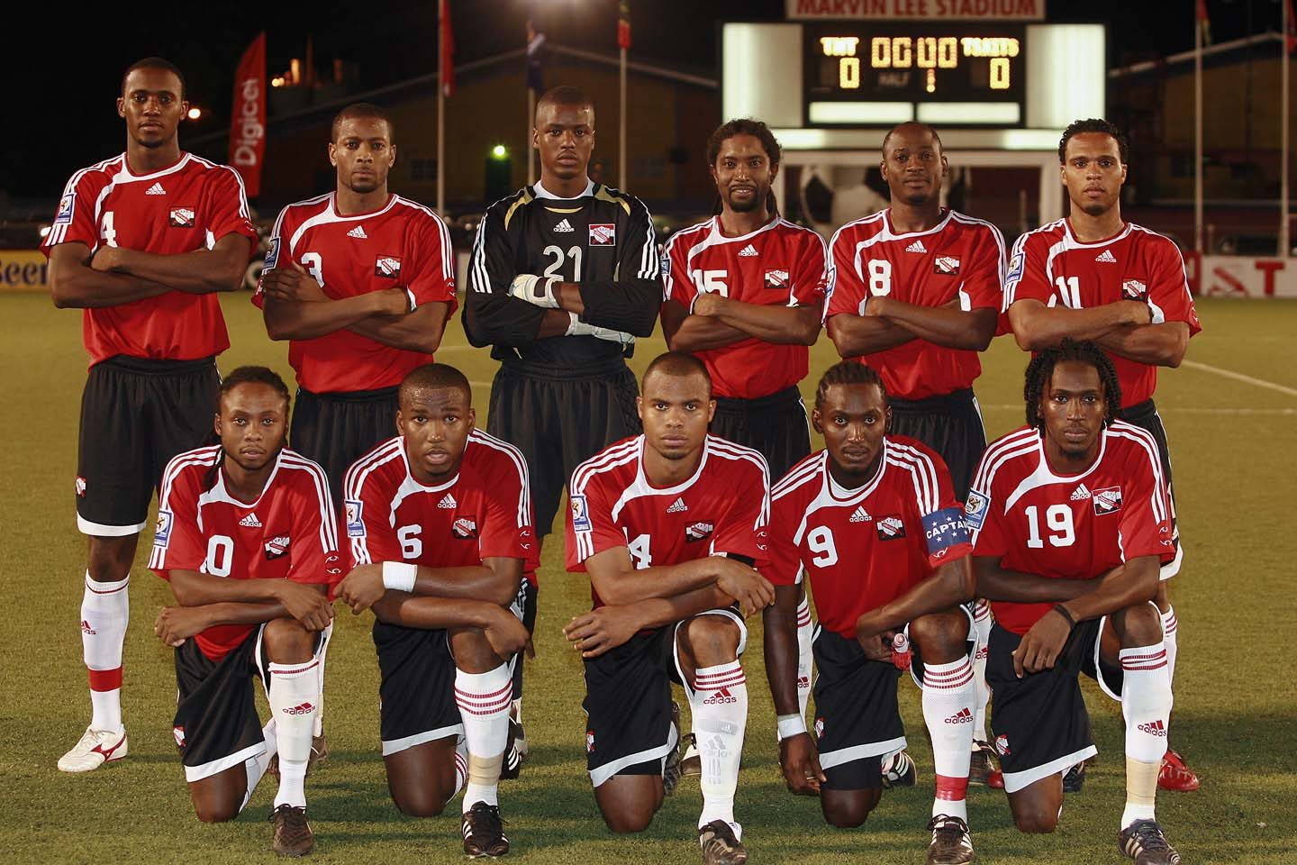 Trinidad-and-Tobago-06-08-adidas-home-kit-red-black-white-line-up.jpg