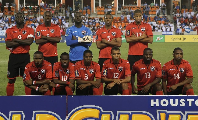 Trinidad-and-Tobago-2013-Joma-home-kit-red-black-red-line-up.jpg
