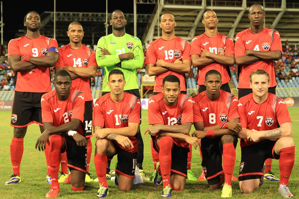 Trinidad-and-Tobago-2013-Joma-new-home-kit-red-black-red-line-up.jpg