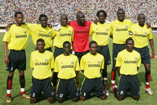 Uganda-07-PUMA-hpme-kit-yellow-black-black-pose.JPG