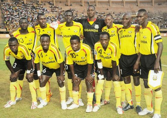 Uganda-09-adidas-home-kit-yellow-black-yellow-pose.JPG