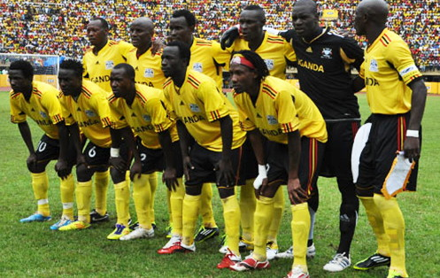 Uganda-11-adidas-home-kit-yellow-black-yellow-line-up.jpg