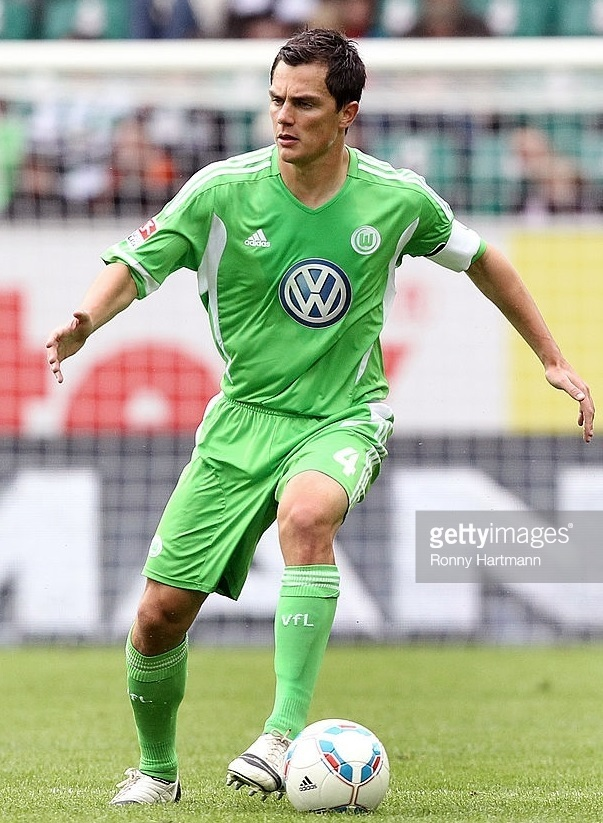VfL-Wolfburg-2011-12-adidas-home-kit-VW-Marcel-Schafer.jpg