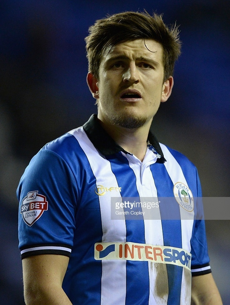 Wigan-Athletic-2014-15-MiFit-home-kit-Harry-Maguire.jpg