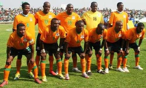 Zambia-11-12-NIKE-home-kit-orange-green-orange-pose.jpg