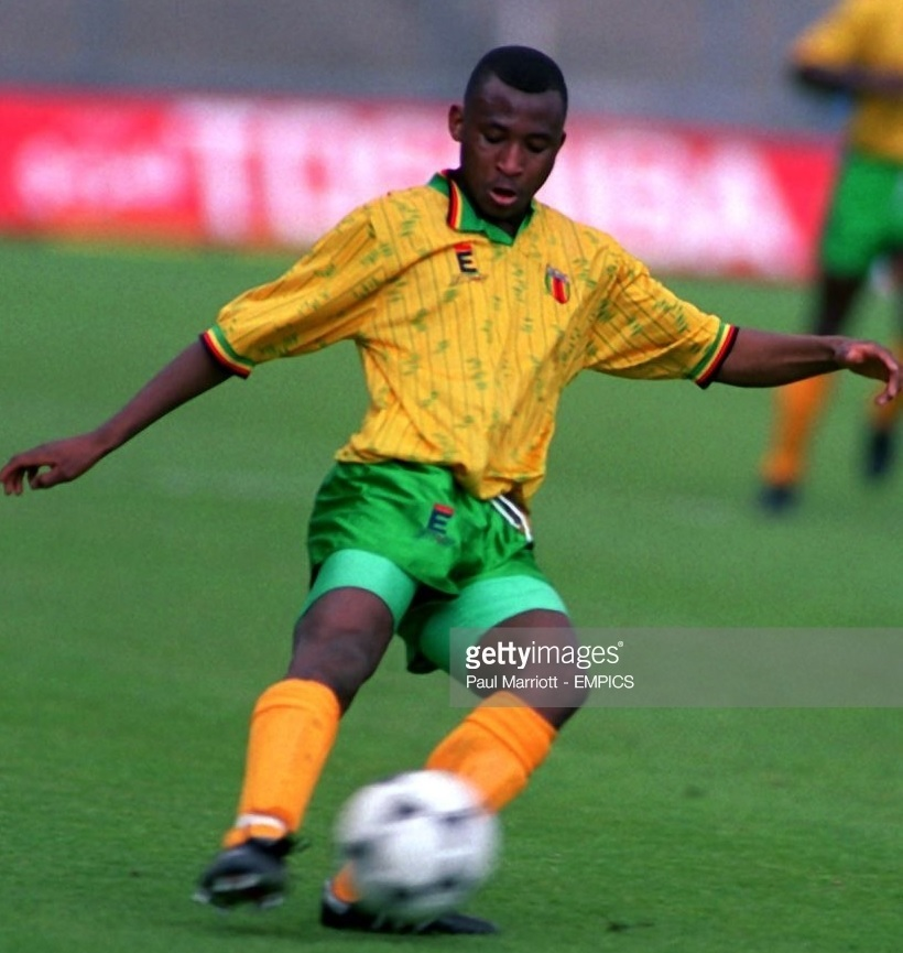 Zimbabwe-1993-En-s-sports-home-kit-yellow-green-yellow.jpg