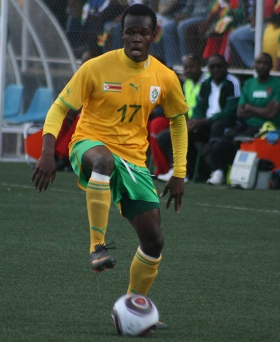 Zimbabwe-2011-PUMA-home-kit-yellow-green-yellow.jpg