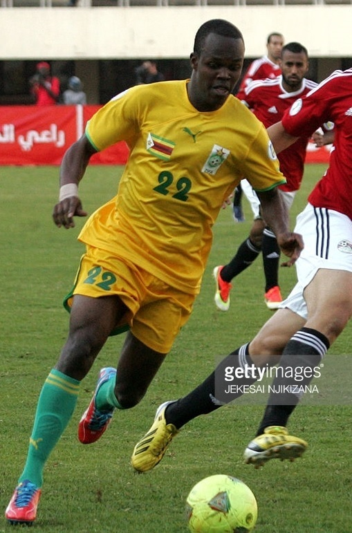 Zimbabwe-2013-PUMA-home-kit-yellow-yellow-green.jpg