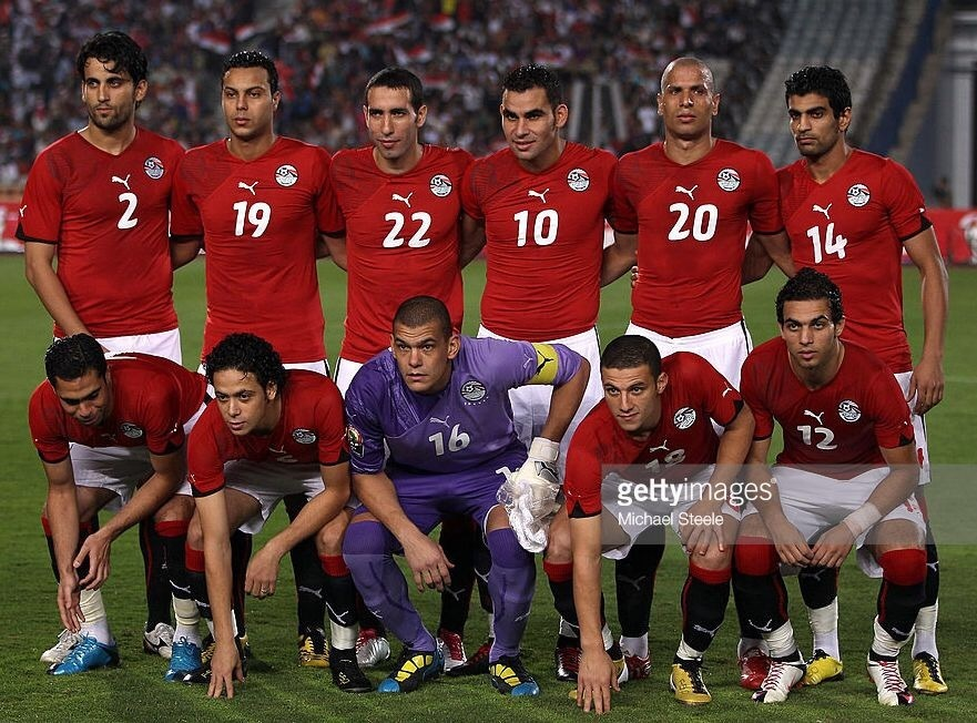 egypt-2010-11-puma-home-kit-red-white-black-line-up.jpg
