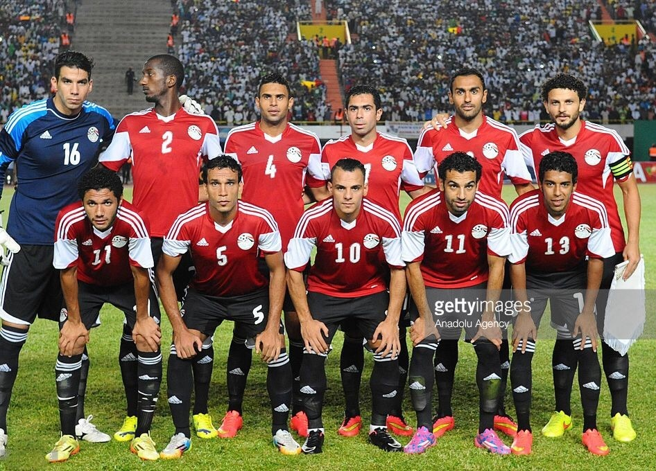 egypt-2014-adidas-home-kit-red-black-black-line-up.jpg