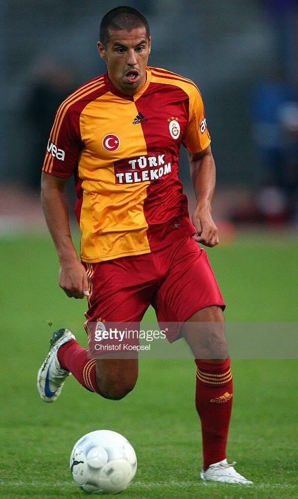galatasaray-2009-10-adidas-home-kit-milan-baros.jpg
