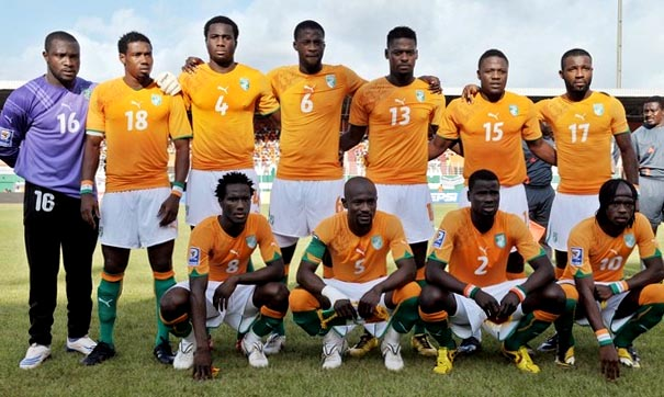 Cote d'lvoire-10-11-PUMA-uniform-orange-white-green-group.JPG