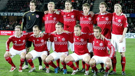Denmark-10-11-adidas-home-kit-red-white-red-pose.jpg
